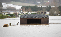 © Licensed to London News Pictures. 22/12/2019. Yalding, UK. Flood water surrounds a horse stable in a field next to the Little Venice caravan park near Yalding in Kent after the River Meday burst its banks. River levels remain high after a second night of heavy rain in the south. More rain is expected today. Photo credit: Peter Macdiarmid/LNP