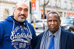 """Mahamoud Ahmed, 79, and his son Maged Abdelmonem celebrate Ahmed's victory at the conclusion of his employment tribunal at Victory House in London after defendant Abdullah Ali Al-Ansari, a diplomat who is currently employed as the Qatari Embassy's head of its medical centre, is alleged to have subjected Mahamoud Ahmed, 79, his former driver and the organisation's night security officer, to mental and physical abuse over a number of years, treating him like a """"personal slave"""" who was """"on call 24 hours a day, 7 days a week"""". London, March 14 2019."""