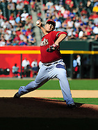 May 1 2011; Phoenix, AZ, USA; Arizona Diamondbacks pitcher David Hernandez (30) delivers a pitch during the eighth inning against the Chicago Cubs at Chase Field. The Diamondbacks defeated the Cubs 4-3. Mandatory Credit: Jennifer Stewart-US PRESSWIRE..