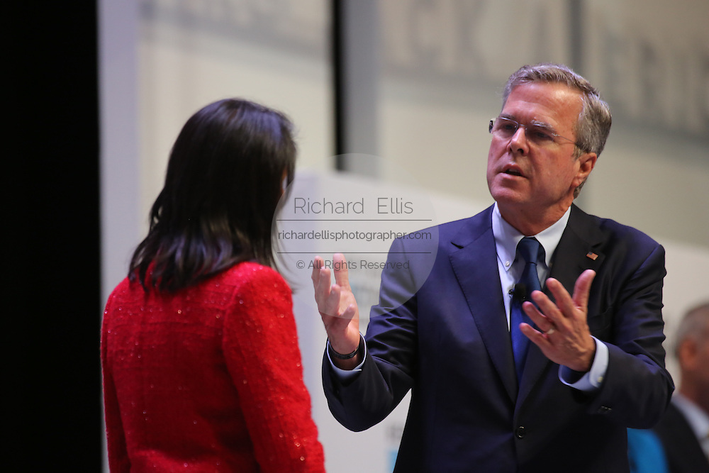 Republican presidential candidate Gov. Jeb Bush replies to a question from South Carolina Gov. Nikki Haley at the Heritage Foundation Take Back America candidate forum September 18, 2015 in Greenville, South Carolina. The event features 11 presidential candidates but Trump unexpectedly cancelled at the last minute.