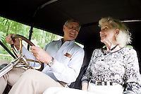 "9 July, 2008. Doylestow, PA. Jim Grundy, 54, and his mother Patricia sit in the 1909 Pierce Arrow antique car.  Patricia Grundy sat in the back seat of this car at the age of 16, when her parents drove from Philadelphia to Detroit to participate at the Glidden Tour. Jim Grundy is the chief executor of Grundy Worldwide, an insurance company for collectible cars. His father Jim Sr. Jr. started the business in 1947 and wrote the first antique car insurance policy in 1949. Jim Grundy has been in the business for 28 years and assumed major interest and the presidency 19 years ago. ""I own the best pre World War I cars ever manufactured"", Mr. Grundy says. <br /> <br /> ©2008 Gianni Cipriano for The Wall Street Journal<br /> cell. +1 646 465 2168 (USA)<br /> cell. +1 328 567 7923 (Italy)<br /> gianni@giannicipriano.com<br /> www.giannicipriano.com"
