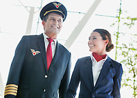 Pilot with flight attendants walking in the airport