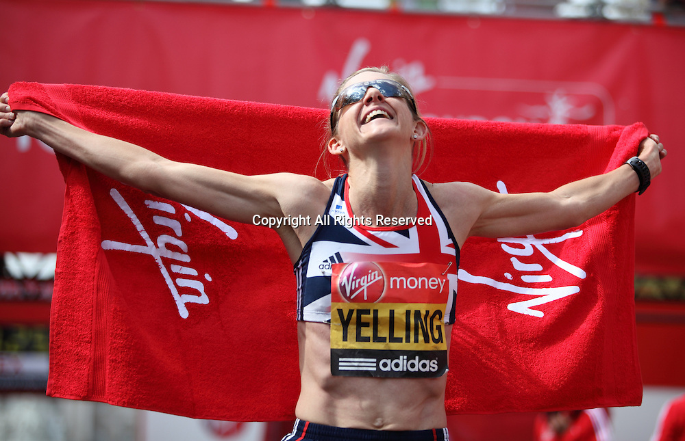 22.04.2012 London, England. Liz Yelling poses for a photo after finishing the 2012 Virgin Womens London Marathon in a time of 2:40:10