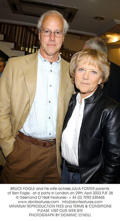 BRUCE FOGLE and his wife actress JULIA FOSTER parents of Ben Fogle,  at a party in London on 29th April 2003.PJF 28