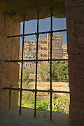 Buildings in old Sanaa viewed through iron grill