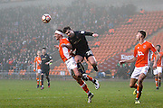 Blackpool's Tom Aldred (15) heads clear from Barnsley's Tom Bradshaw (20) during the The FA Cup 3rd round match between Blackpool and Barnsley at Bloomfield Road, Blackpool, England on 7 January 2017. Photo by Craig Galloway.