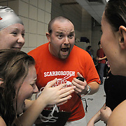 2/21/11 -- BRUNSWICK, Maine.  Scarborough swim coach Eric French, center, gives his girls relay team a shout of encouragement after their 3rd place finish in the 400 Freestyle relay. Scarborough finished an expected 6th overall, but was more successful in their times -- with many personal and team bests at Maine High School Girls Class A Swimming and Diving Championships at Bowdoin College on Monday night. At the final tally, Bangor came away ahead of Morse by 33 points, who led the 3rd place team, Cheverus, by 68.  Photo by Roger S. Duncan.