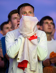 © Licensed to London News Pictures. 03/07/2018. Brighton, UK. England fans suffer the agony and extract of a penalty shootout, which they eventually won in the World Cup second round match between England and Colombia on a big screen on Brighton beach, on the south coast of England. Photo credit: Ben Cawthra/LNP