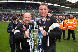 Free to use courtesy of Sky Bet - Bolton Wanderers manager Phil Parkinson (R) holds the trophy with his assistant Steve Parkin (L) as Bolton Wanderers celebrate finishing the season as Sky Bet League One runners up to secure automatic Promotion to the 2017/18 Sky Bet Championship - Rogan Thomson/JMP - 30/04/2017 - FOOTBALL - Macron Stadium - Bolton, England - Bolton Wanderers v Peterborough United - EFL Sky Bet League One.
