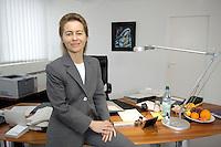 12 DEC 2005, BERLIN/GERMANY:<br /> Ursula von der Leyen, CDU, Bundesfamilienministerin, in ihrem Buero, Bundesministerium fuer Familie, Senioren, Frauen, und Jugend<br /> Ursula von der Leyen, Federal Minister for family, Seniors, Women and Youth, in her office<br /> IMAGE: 20051212-01-029<br /> KEYWORDS: Büro, Schreibtisch