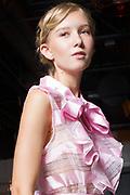 Fashion photograph of teen model Rayna Nicole van Keuren on runway for Houston Fashion Week by Gerard Harrison.