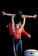 Sep 21, 2008; San Jose, CA, USA; Morgan Hamm (bottom) and Tasha Schwikert (top) perform on the floor during the 2008 Tour of Gymnastics Superstars post-Beijing Olympic tour at HP Pavilion. Mandatory Credit: Kyle Terada-Terada Photo