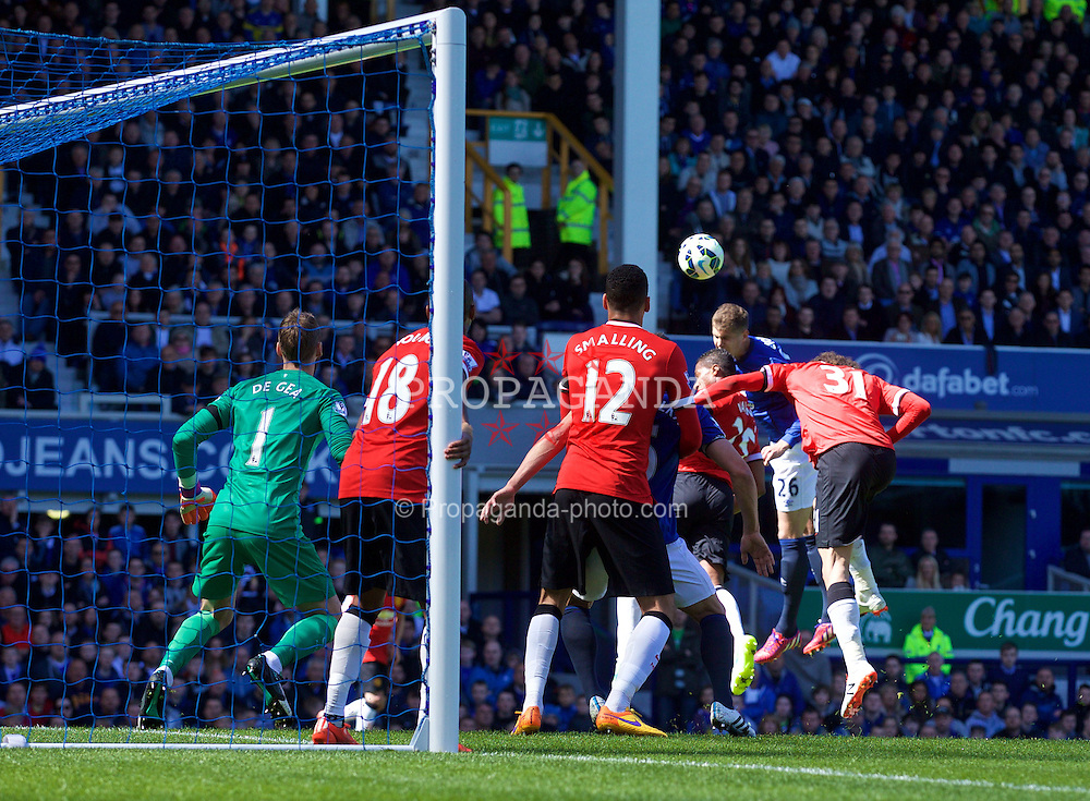 LIVERPOOL, ENGLAND - Sunday, April 26, 2015: Everton's John Stones scores the second goal against Manchester United during the Premier League match at Goodison Park. (Pic by David Rawcliffe/Propaganda)