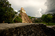 The sun sets on the Temple of the Great Jaguar (Temple I). Located in the Petén Basin region of northern Guatemala, Tikal is one of the largest pre-Columbian Mayan cities in Mesoamerica. The Temple of the Great Jaguar stands 55 metres (180 ft) tall, and is only surpassed by Temple IV at 70 metres (230 ft).