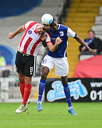 Lincoln City's Matt Rhead vies for possession with Moussa Diarra<br /> <br /> Picture: Chris Vaughan/Chris Vaughan Photography<br /> <br /> Football - Vanarama National League - Lincoln City Vs Barrow - Saturday 17th September 2016 - Sincil Bank - Lincoln<br /> <br /> Copyright © 2016 Chris Vaughan Photography. All rights reserved. Unit 11, Churchill Business Park, Bracebridge Heath, Lincoln, LN4 2FF - Telephone: 07764170783 - info@chrisvaughanphotography.co.uk - www.chrisvaughanphotography.co.uk