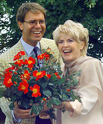 File photo dated 5/7/1999 of Sir Cliff Richard, who has won his legal action against the BBC over coverage of a police raid at his apartment in Berkshire in August 2014, and Gloria Hunniford with a Jill Dando rose at the Hampton Court Flower Show, London.