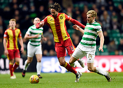 Celtic's Stuart Armstrong and Partick's Adam Barton battle for the ball during the Scottish Premiership match at Celtic Park, Glasgow.