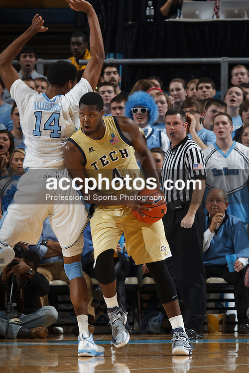 CHAPEL HILL, NC - JANUARY 23: Robert Carter #4 of the Georgia Tech Yellow Jackets maneuvers around Desmond Hubert #14 of the North Carolina Tar Heels on January 23, 2013 at the Dean E. Smith Center in Chapel Hill, North Carolina. North Carolina won 63-79. (Photo by Peyton Williams/UNC/Getty Images) *** Local Caption *** Desmond Hubert;Robert Carter