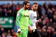 Derby County goalkeeper Scott Carson (1)chats to Derby County defender Richard Keogh (6) during  a break in play during the EFL Sky Bet Championship match between Aston Villa and Derby County at Villa Park, Birmingham, England on 2 March 2019.