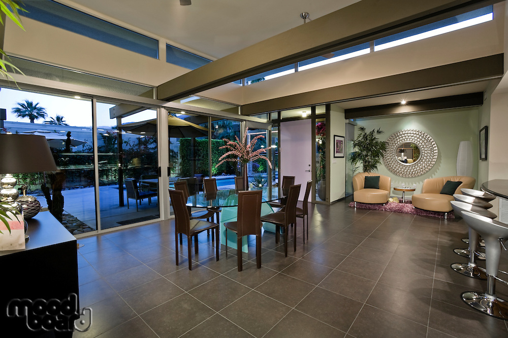 Open plan home interior with areas designated for dining and relaxing