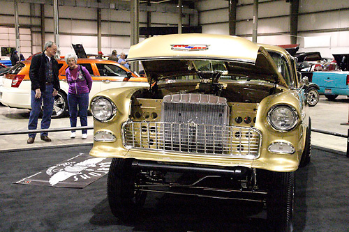 Bill Pitzer of Wilmington (left) and Carol Stone of Clarksville look at Ray & Darleena Thenot of Dayton's 1955 Chevrolet during the KOI Hot Rod Fest Dayton at the Dayton Airport Expo Center in Vandalia, Sunday, March 12, 2012.