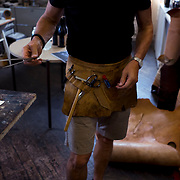Alfred Stadler artist and designer of fine crafted leather products conducts an afternoon of demonstrations for participants of Made in Brooklyn Tours with founder  Dom Gervasi.