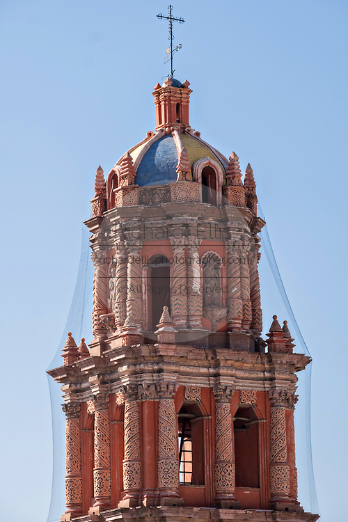 A bell tower on the baroque style Cathedral of San Luis Potosi in the historic center on the Plaza De Armas in the state capital of San Luis Potosi, Mexico. Also known as the San Luis Potosi Metropolitan Cathedral, it is consider the most important monument in the state and the first Baroque style building constructed in 1670 on the site of a parish church first built in 1593.
