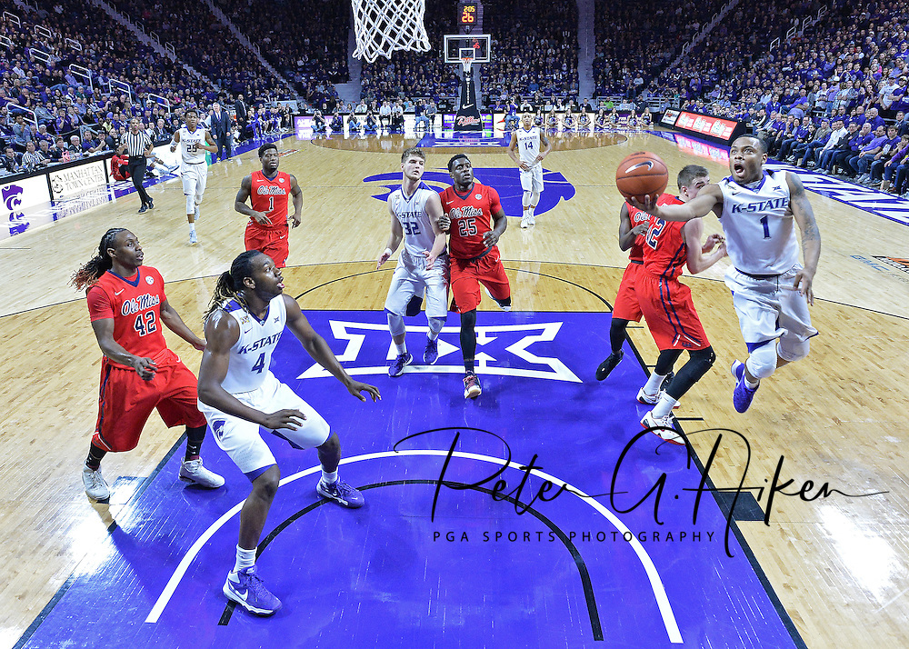 Guard Carlbe Ervin II #1 of the Kansas State Wildcats drives in for a basket past forward Tomasz Gielo #12 of the Mississippi Rebels during the first half at Bramlage Coliseum in Manhattan, Kansas.