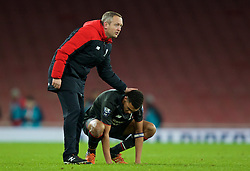 LONDON, ENGLAND - Friday, March 4, 2016: Liverpool's manager Neil Critchley consoles his captain Trent Alexander-Arnold after the defeat against Arsenal during the FA Youth Cup 6th Round match at the Emirates Stadium. (Pic by Paul Marriott/Propaganda)