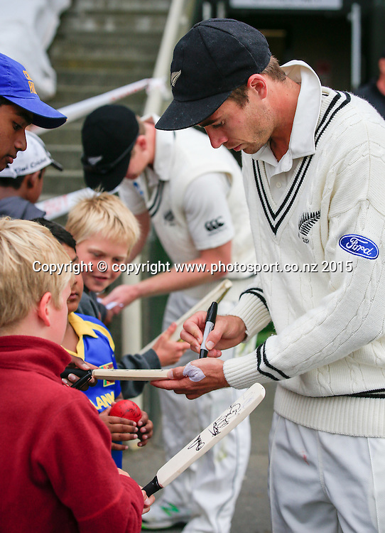 Tim Southee signs autographs for fans. Fourth day, second test, ANZ Cricket Test series, New Zealand Black Caps v Sri Lanka, 06 January 2015, Basin Reserve, Wellington, New Zealand. Photo: John Cowpland / www.photosport.co.nz