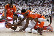 FAYETTEVILLE, AR - NOVEMBER 30:  Coty Clarke #4 of the Arkansas Razorbacks dives for a loose ball on the floor during a game against the Syracuse Orangemen at Bud Walton Arena on November 30, 2012 in Fayetteville, Arkansas.  The Orangemen defeated the Razorbacks 91-82.  (Photo by Wesley Hitt/Getty Images) *** Local Caption *** Coty Clarke