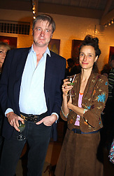 The MARQUESS & MARCHIONESS OF WORCESTER at an exhibition of recent work by artist Lance Tilbury held at the Old Imperial Laundry, Warriner Gardens, Battersea, London on 7th December 2004.<br />