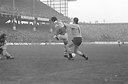 Dublin pulls Kerry player back to prevent him getting to the ball during the All Ireland Senior Gaelic Football Final, Kerry v Dublin in Croke Park on the 28th September 1975. Kerry 2-12 Dublin 0-11.