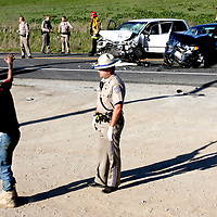 Highway patrol officer Grant Boles administers a field sobriety test to Sherri Chinn, who was later arrested for driving under the influence in connection with a fatal crash on Highway 1 south of Davenport on Sunday. Chinn veered into oncoming traffic in her white Honda van, hit a motorcyclist head on before slamming into a black BMW driven by the motorcyclist's wife..  The motorcyclist died at the scene.