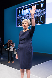 © Licensed to London News Pictures . 04/10/2017. Manchester, UK. Prime Minister THERESA MAY waves from the stage after delivering her keynote speech on the fourth and final day of the Conservative Party Conference at the Manchester Central Convention Centre . Photo credit: Joel Goodman/LNP