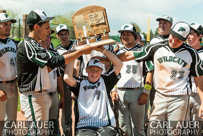 May 17th 2013: Fleming Wildcats senior Jeremy Richhard-Kind (7) hoists the Colorado State Championship trophy over his head with his teammates surrounding him after his team defeated the Holly Wildcats 5-3 in the CHSAA 1A Baseball final at All Star Park in Lakewood, Colorado