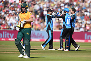 Daryl Mitchell, Ben Cox, and Ed Barnard of Worcestershire Rapids celebrate the wicket of Chris Nash during the Vitality T20 Finals Day 2019 match between Notts Outlaws and Worcestershire Rapids at Edgbaston, Birmingham, United Kingdom on 21 September 2019.