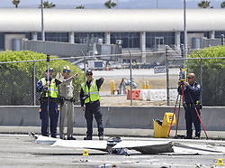 June 30, 2017 - Irvine, California, USA - Investigators look over the scene of a small plane that crashed on the 405 freeway near John Wayne Airport in Irvine, California, on Friday, June 30, 2017. ..The twin-engine Cessna 310 was on approach to John Wayne Airport when it hit the center divider of the freeway and crashed on the southbound side. (Credit Image: © Jeff Gritchen/The Orange County Register via ZUMA Wire)