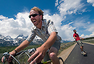 "NEWS&GUIDE PHOTO / PRICE CHAMBERS.Dave Coyne tows skateboarder Lance Downing along the new pathway in Grand Teton National Park on Saturday. ""It's the innaugural tow run of the multi-use bike path,"" Coyne said. ""Our first descent of Blacktop Coulior."""