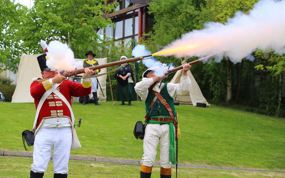 "24/05/2013. Free To Use Image. Rebellion. Pictured is Ray Murphy and Peter Freeman firing their muskets at the re-launch of the National 1798 Rebellion Centre in Enniscorthy, the event is celebrated by a free Rebellion weekend from May 25 - 26 for details of the weekend of free activities see www.rebellion.ie. Picture: Patrick Browne<br /> <br />  Newly Re-developed National 1798 Rebellion Centre Opened<br />  <br /> Today (Friday May 24) the newly re-developed National 1798 Rebellion Centre in Enniscorthy, Co Wexford was officially re-launched by Cllr Sean Doyle, Chairperson of the National 1798Centre at their celebratory weekend long Rebellion Weekend.<br />  <br /> The Centre has been undergoing a new look since earlier this year and a brand new tour has been developed under a project funded by Wexford Local Development to the value €178,000 and supported by Wexford County Council and Enniscorthy Town Council.<br />  <br /> The Centre was officially opened in 1998, during bi-centenary commemorations, to illustrate the significance of the 1798 Rebellion. According to the centre Manager Jacqui Hynes the exhibition was in need of upgrade. Jacqui says ""This brand new exhibition and tour tells the story of the 1798 Rebellion in a fresh and interactive way, the audience is taken on a journey by General Lake, John Shehan who is 'The Croppy Boy', the United Irishman leader Anthony Perry, and the dreaded 'Tom The Devil'. We had some school children in this morning taking a tour and the feedback has been fantastic, they are very much enjoying the new experience and of course learning lots. Their teachers also had the height of praise for the fun yet educational way information of the events is given.  For instance the tour includes a fact-finding hunt for quirky facts from the rebellion a 'Pikeman Secret Investigation' to see if they can uncover the secret facts of the Rebellion.""<br />  <br /> The Centre was officially re-launched by Cllr Sean Doyle, Chairperson of the National 1798 Centre Board of Directors. Com"