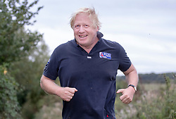 © Licensed to London News Pictures. 11/09/2018. Thame, UK. Boris Johnson smiles at reporters as he returns from a morning run at his Oxfordshire house . Last week it was announced that Boris Johnson and his wife Marina Wheeler are getting divorced. Photo credit: Peter Macdiarmid/LNP