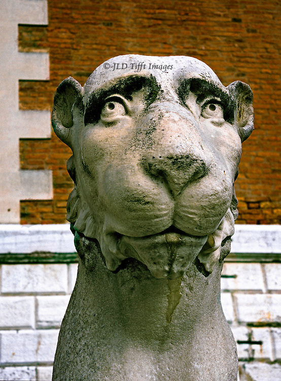 Ancient Greek statue of a lion, possibly from Delos, stolen from Greece by Venetians in 17th century and installed at the 15th century gate of the Arsenale in Venice.  The lion wears a quizzical, shy facial expression.
