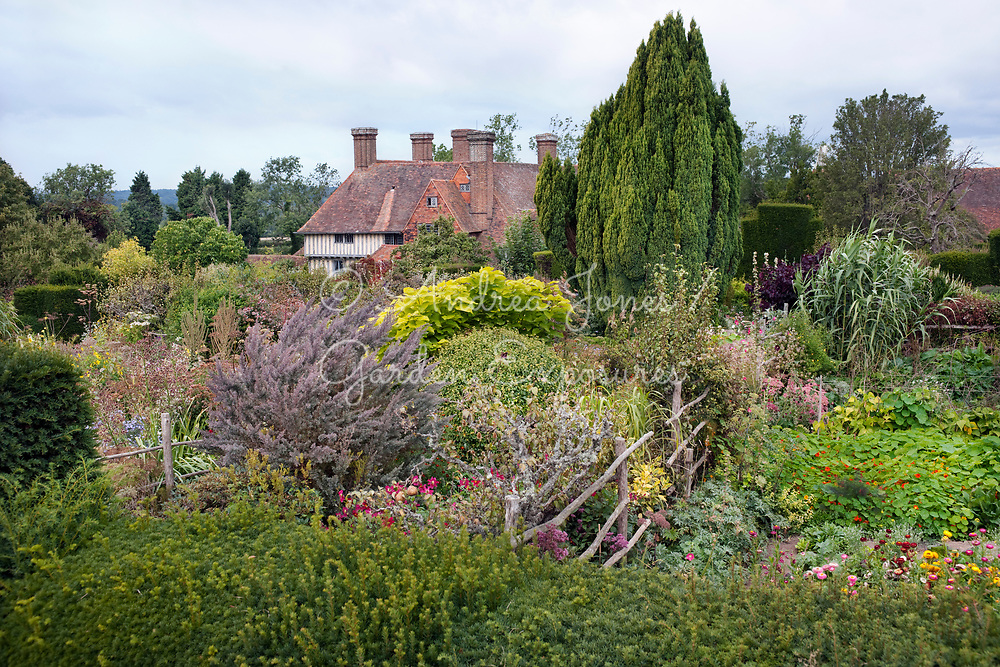 The High Garden borders in late summer with Great Dixter House