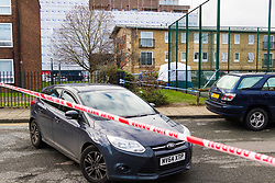 Barking, London - The scene at a housing estate on Abbey Road in Barking, London where a 19 year old died of stab wounds on 3 February 2018 despite attempts by paramedics to save his life. Scotland Yard's murder squad are investigating and have made no arrests so far. PICTURED: A tent, centre, covers the site of the stabbing in a car park next to a basketball court behind flats. February 04 2018.