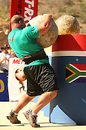 Derek Poundstone (USA) giving his all to place the final and heaviest Atlas Stone on the platform during the final rounds of the World's Strongest Man competition held in Sun City, South Africa.