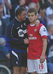 BOLTON, ENGLAND - Easter Sunday, April 24, 2011: Arsenal's Jack Wilshere is consoled by Bolton Wanderers' manager Owen Coyle after the Premiership match at the Reebok Stadium. (Photo by David Rawcliffe/Propaganda)