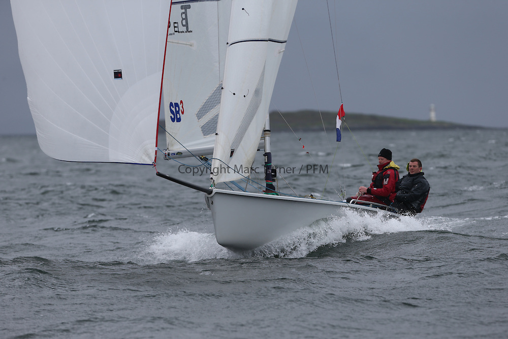 The Clyde Cruising Club's Scottish Series held on Loch Fyne by Tarbert. <br /> Day 4 Racing with a wet Southerly to start clearing up for the last race.<br /> <br /> GBR3038 ,Ten Bob Slider , Lennox / Mackay/ Simpson, Aberdeen&amp;Stonehaven YC, SB20