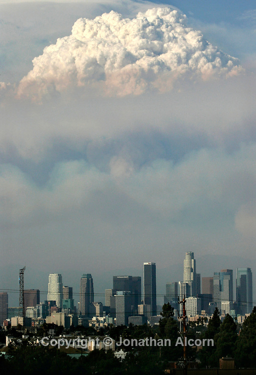 Aug 30, 2009 -Los Angeles, California, USA - A pyrocumulus or fire cloud from the out of control Station fire rises over downtown Los Angels The fire is burning the Angeles National Forest northeast of downtown Los Angeles. .(Credit Image: © Jonathan Alcorn/ZUMA Press)