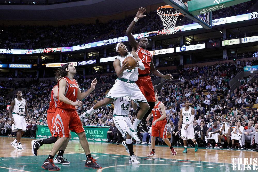 06 March 2012: Boston Celtics small forward Paul Pierce (34) goes for the layup against Houston Rockets center Samuel Dalembert (21) during the Boston Celtics 97-92 (OT) victory over the Houston Rockets at the TD Garden, Boston, Massachusetts, USA.