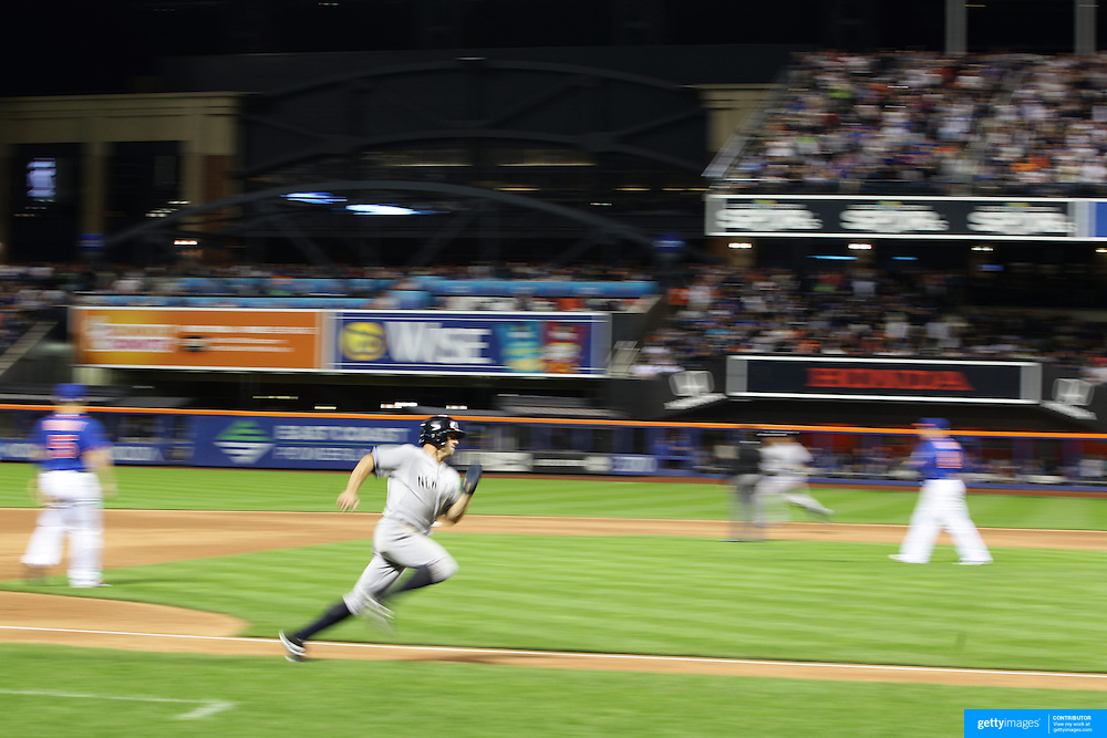 Brett Gardner, New York Yankees, heads to home plate to score a run off a Carlos Beltran  double during the New York Mets Vs New York Yankees MLB regular season baseball game at Citi Field, Queens, New York. USA. 20th September 2015. Photo Tim Clayton